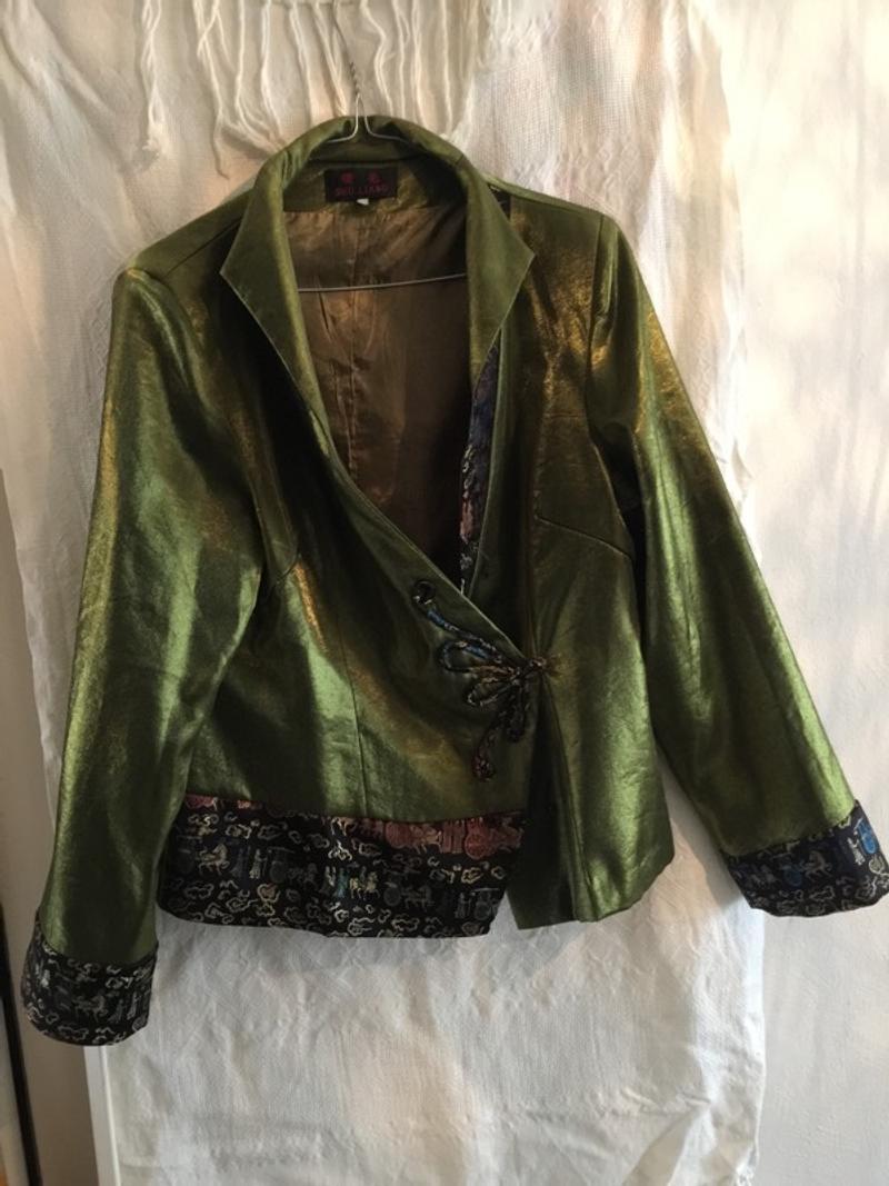 Glimmende groene blazer